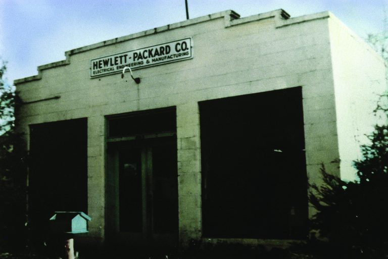 A cinder block building with a sign reading Hewlett-Packard Co. Electrical Engineering & Manufacturing.