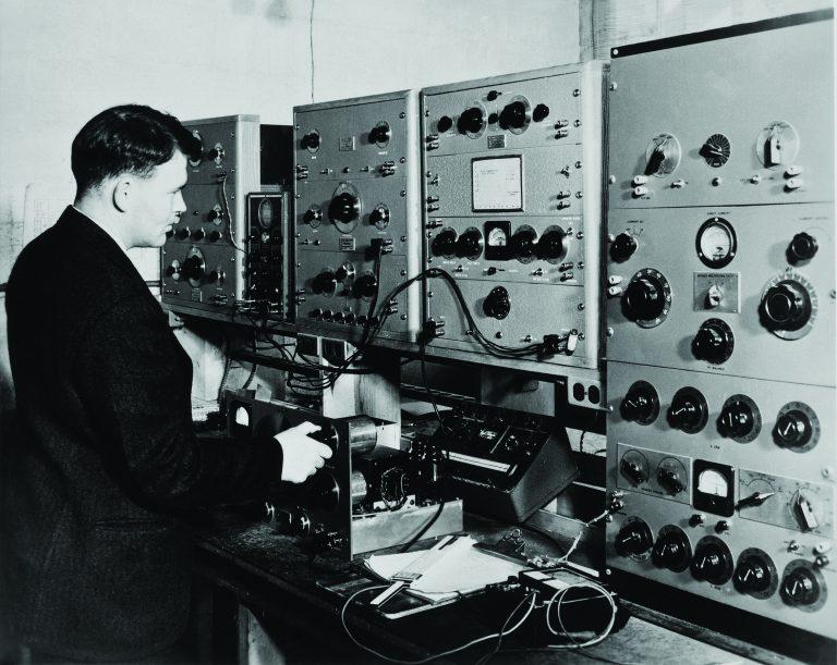 Bill Hewlett working with an audio signal generator.