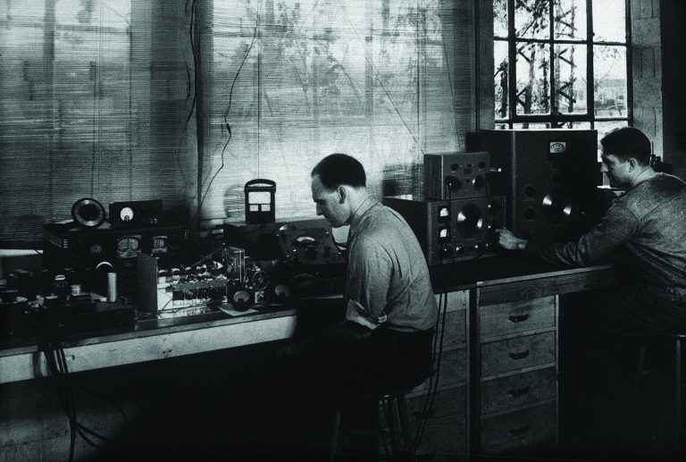 Photo of Vic Carson working at a workbench.