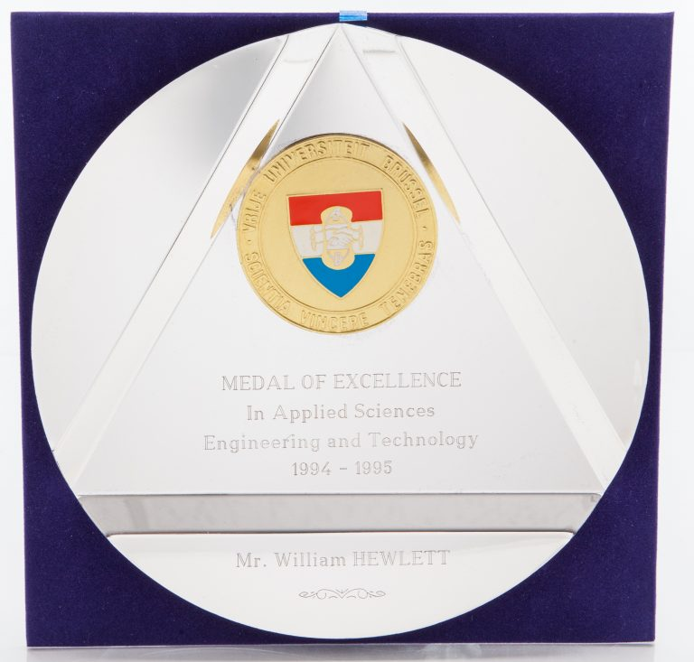 Front of the Medal of Excellence in Applied Sciences inscribed to Bill Hewlett.