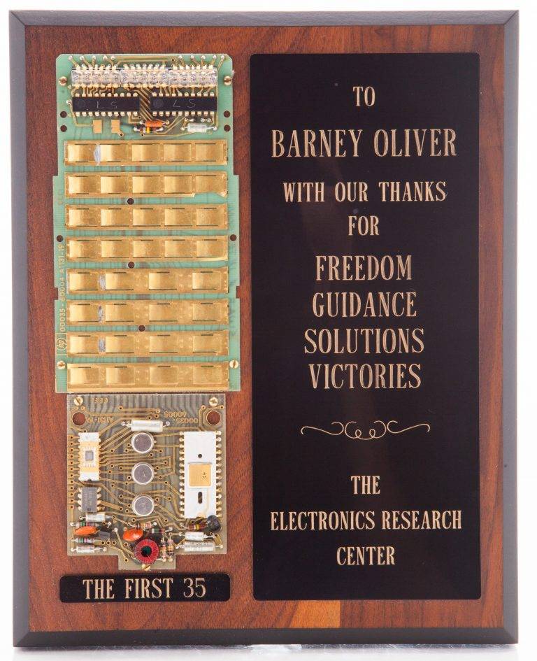 Plaque given to Barney Oliver with mounted components of the first HP 35 logic chip and keyboard infrastructure.