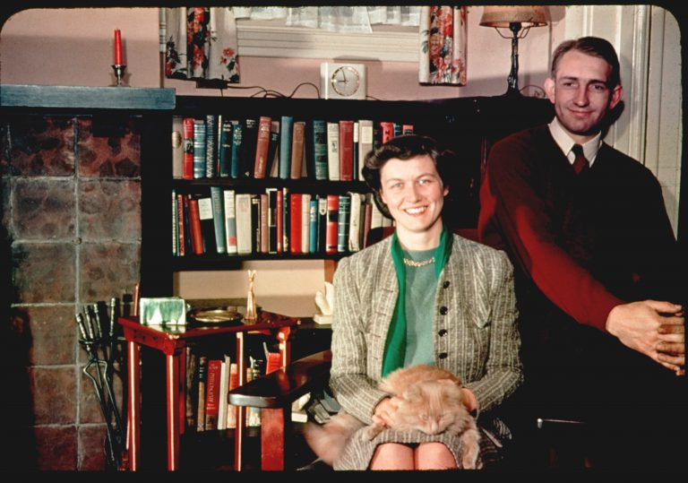 Photo of Lucile Salter Packard with a cat in her lap and Dave Packard sitting next to her.