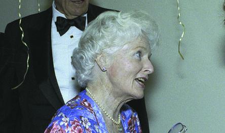 Rosemary Hewlett shaking hands with opera singer Beverly Sills.