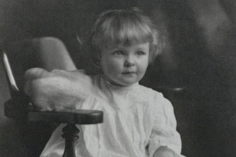Bill Hewlett posing in a chair as a child in 1915.