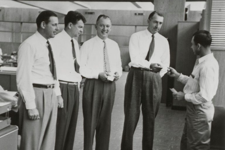 Bill and Dave chatting with Noel Porter and others in 1955.