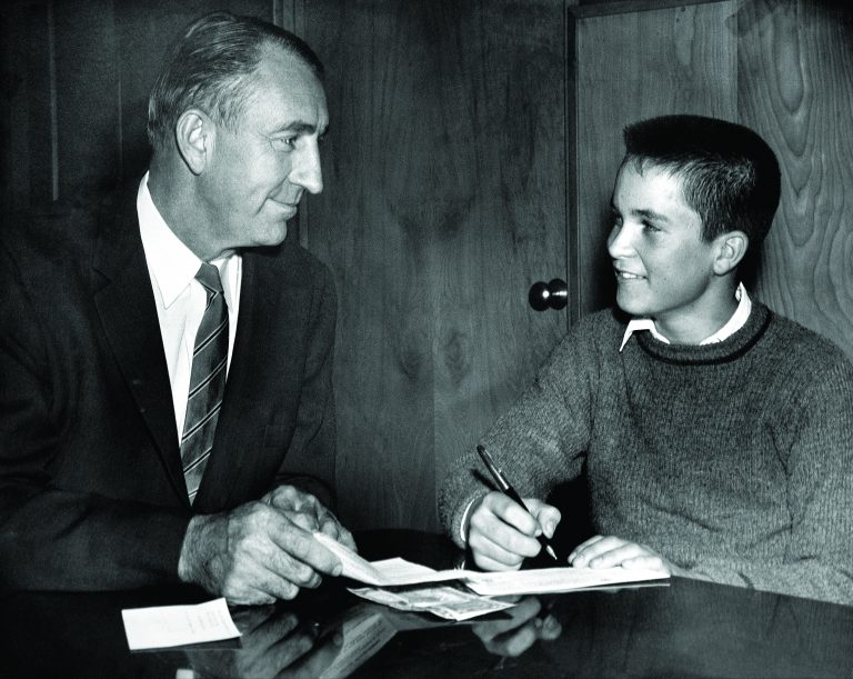 Dave Packard working with a student as part of the Junior Achievement program in 1959.