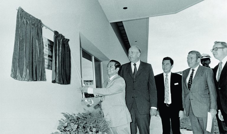 Bill Hewlett, Dave Packard and other men during the unveiling of a sign at Hewlett-Packard Malaysia in 1972.