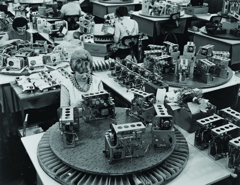 Three women working on a production line at Hewlett-Packard featuring Lazy Susans in 1961.