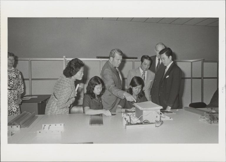 Hewlett and Packard speaking with employees in the 1970s.