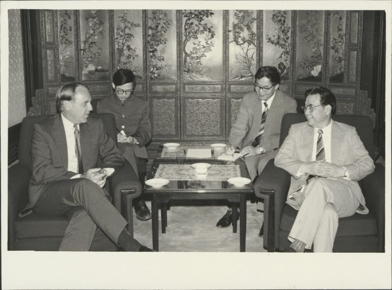 Hewlett-Packard CEO John Young speaks with Chinese officials during a visit to China in 1984.
