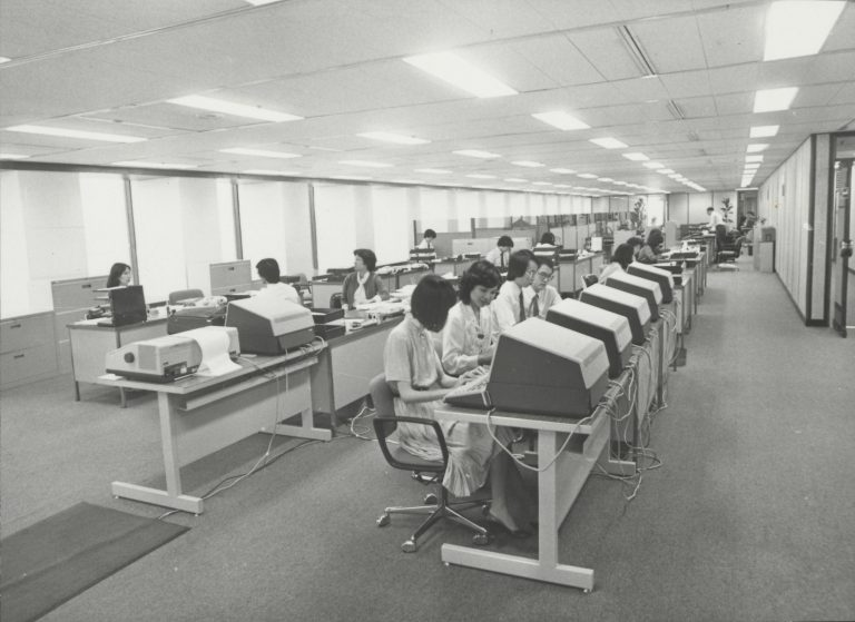 Photo of employees working at terminals in Hewlett-Packard's Hong Kong office in 1981.