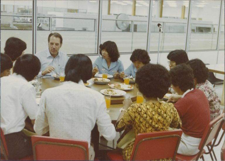 HP CEO John Young spending time with employees during a trip to Hewlett-Packard Malaysia in the 1980s.