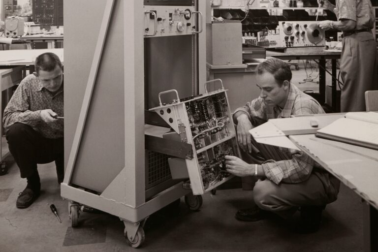 Technicians from the Dynac Division working on the DY-2500 Computing Digital Indicator.
