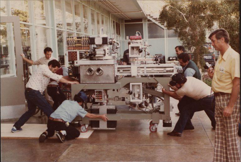 Men moving Hewlett-Packard's e-beam system in 1984.