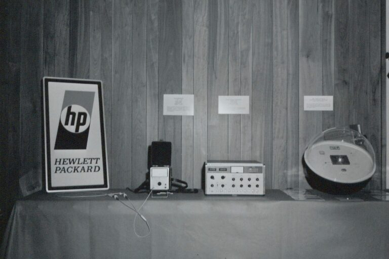 HP's 1967 logo. The letters h & p sit inside a circle with shading above/below and Hewlett and Packard spelled out at bottom.