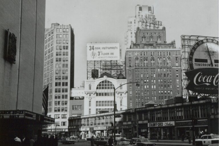 Photo of a billboard indicating 34 new instruments featured by HP on 3rd floor of the IRE in 1957.