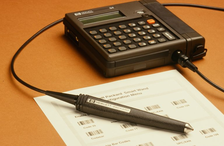 Photo of the HP 94 Handheld Computer with attached barcode wand.