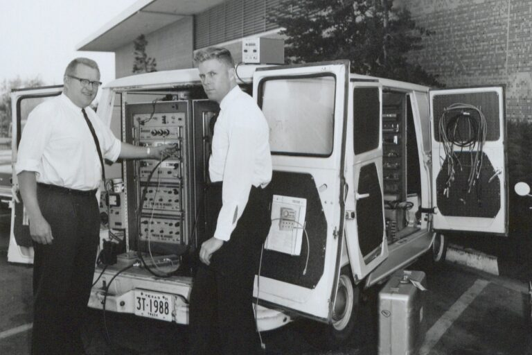 A white van that has been outfitted with HP equipment to serve as a Travelab in the 1960s.