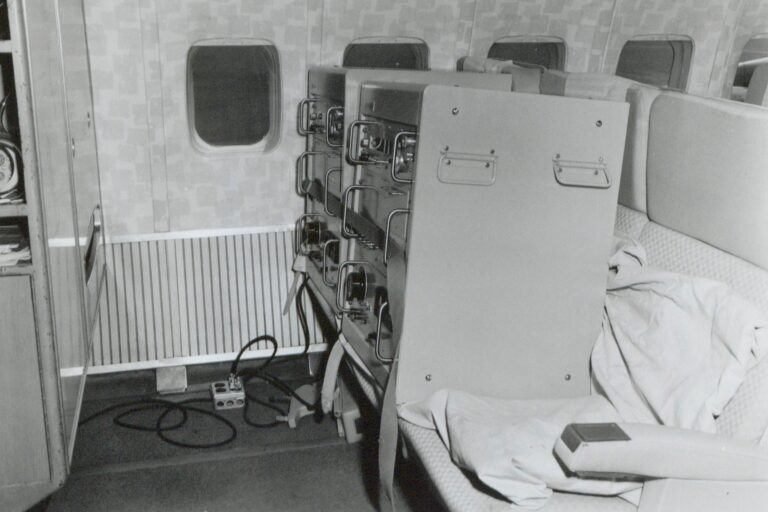 Photo of two HP 5060As in commercial airplane seats during their global tour.