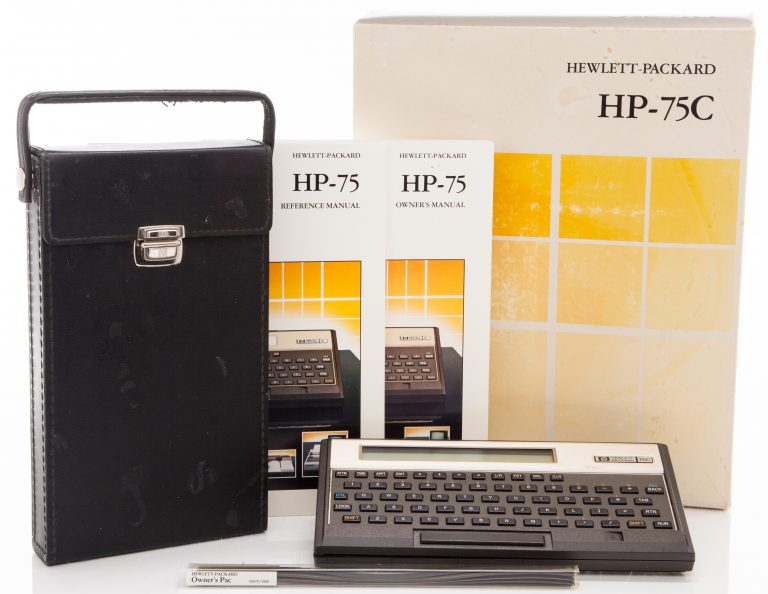 Photo of the HP 75C including carrying case, reference manual and owner's manual.