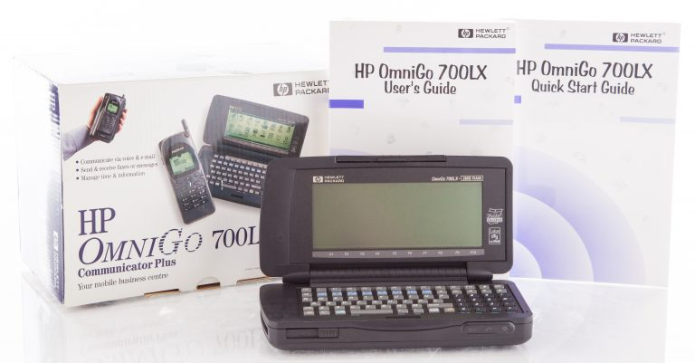 Photo of the OmniGo 700LX including box, User's Guide and Quick Start Guide.