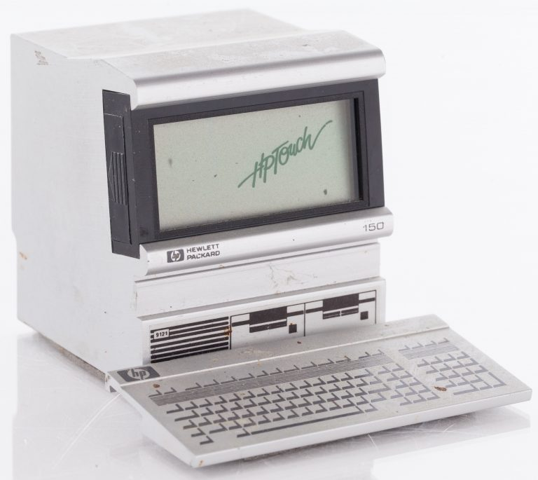 A small promotional toy that resembles the HP 150 touchscreen computer. The 150's screen is a digital clock.