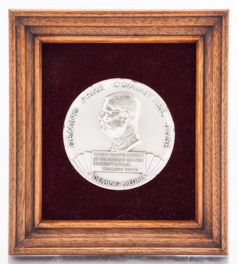 Front view of the Deming Prize featuring a profile view of W. Edwards Deming.