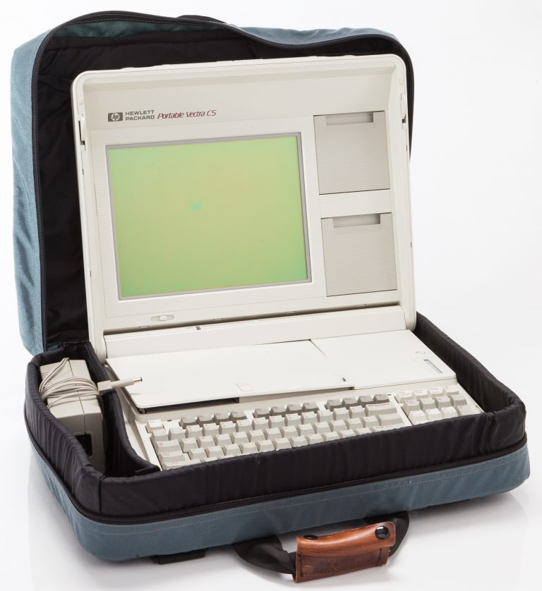 The Hewlett-Packard Vectra portable computer in carrying case with power adapter.