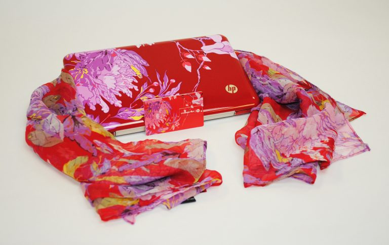 The Hewlett-Packard mini laptop designed by Vivienne Tam with a matching scarf.