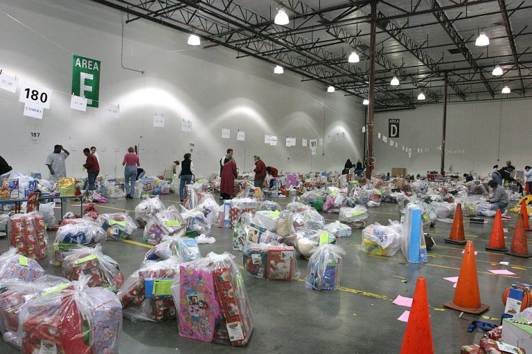Hewlett-Packard employees work to bundle bags of toys as part of the Family Giving Tree program in 2016.