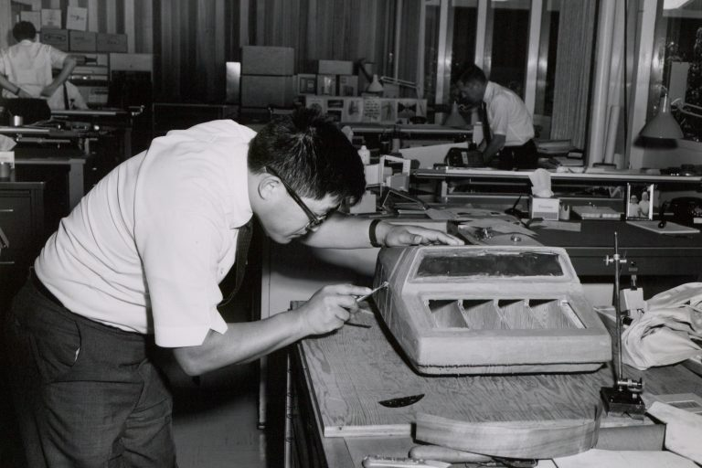 Designer Roy Ozaki crafting a visual prototype of the  HP 9100A desktop calculator out of clay.