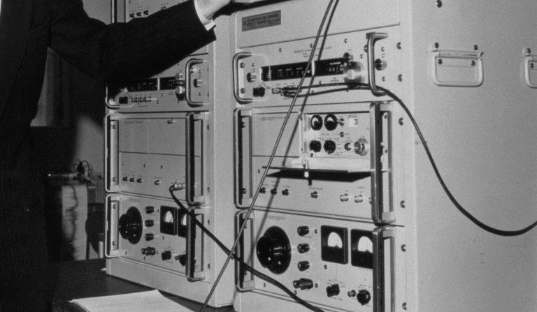 A man works on Hewlett-Packard's 5060A atomic clock in 1964.