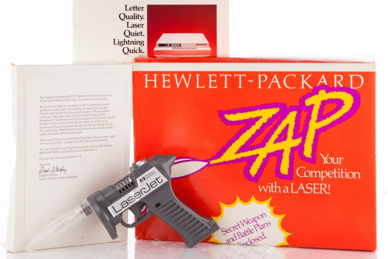Toy laser gun and associated materials promoting HP's LaserJet technology.