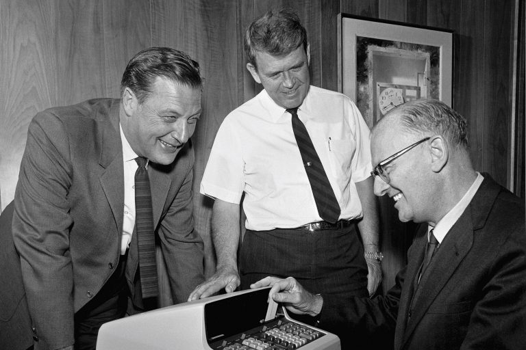 Barney Oliver and Bill Hewlett showing science fiction author Arthur C. Clarke a prototype of the HP 9100A.