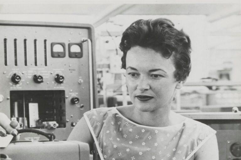 A woman assembling a Hewlett-Packard oscillator in the 1950s or 1960s.