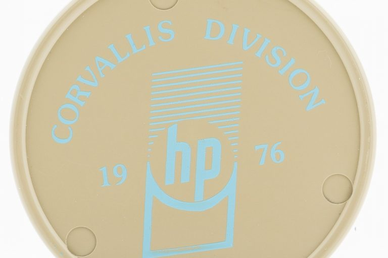A coaster celebrating the opening of Hewlett-Packard's Corvallis facility in 1976.