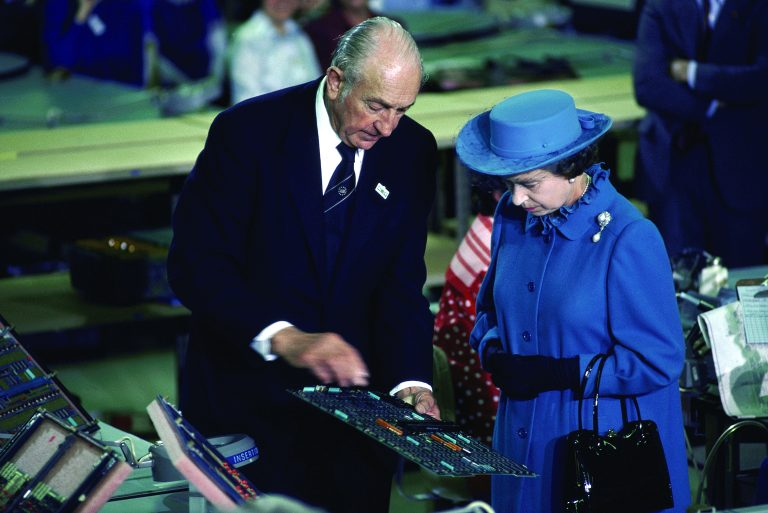 Photo of Dave Packard showing a circuit board to Queen Elizabeth II during her visit to HP Cupertino.