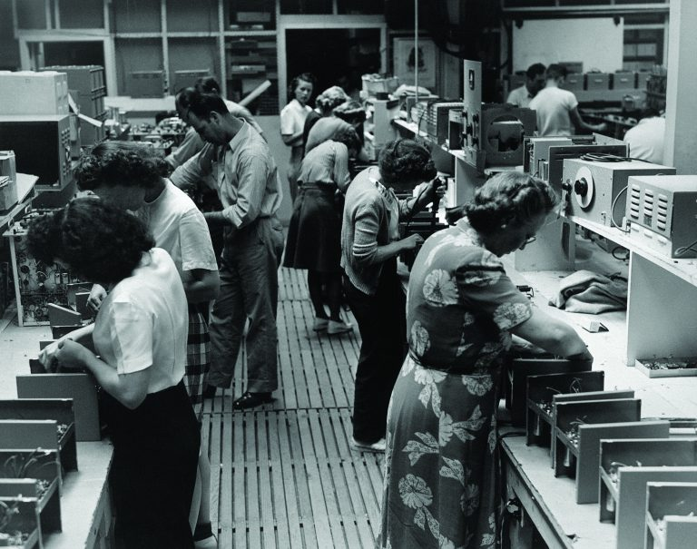 Hewlett-Packard employees working on the pass-on assembly line in 1946.
