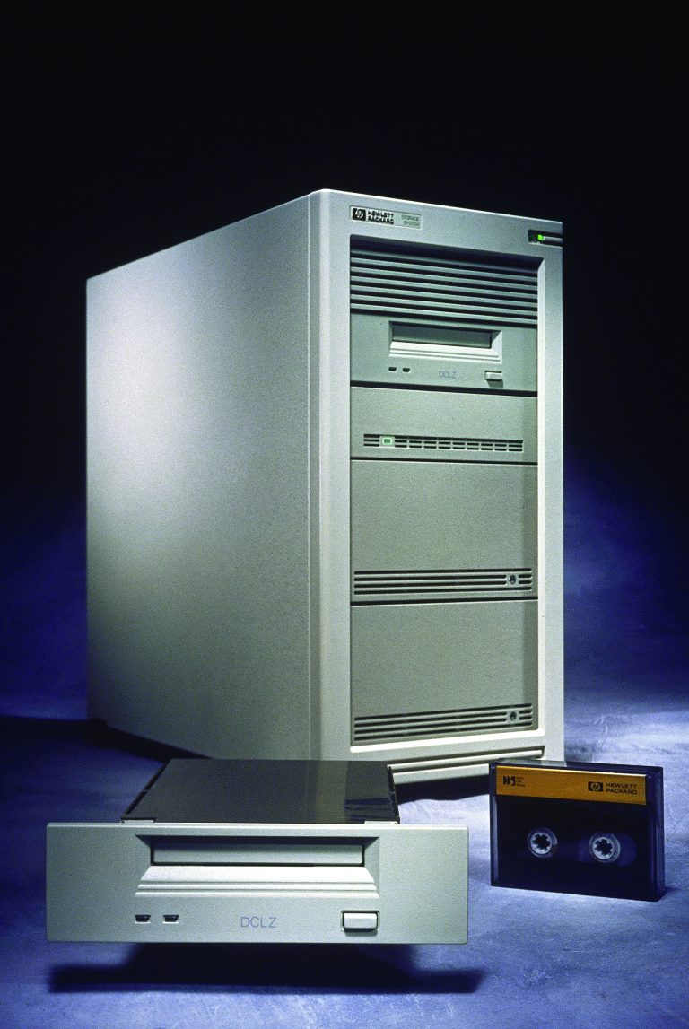 HP's Digital-Data-Storage Data-Compressed Digital Audio Tape system with a drive and digital tape showcased in front.