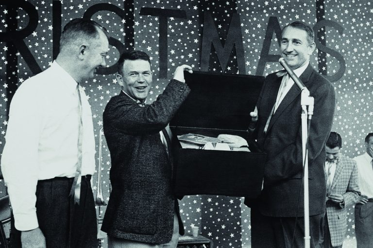 Bill Hewlett and Dave Packard presenting a box of gifts during a Hewlett-Packard holiday party in 1947.