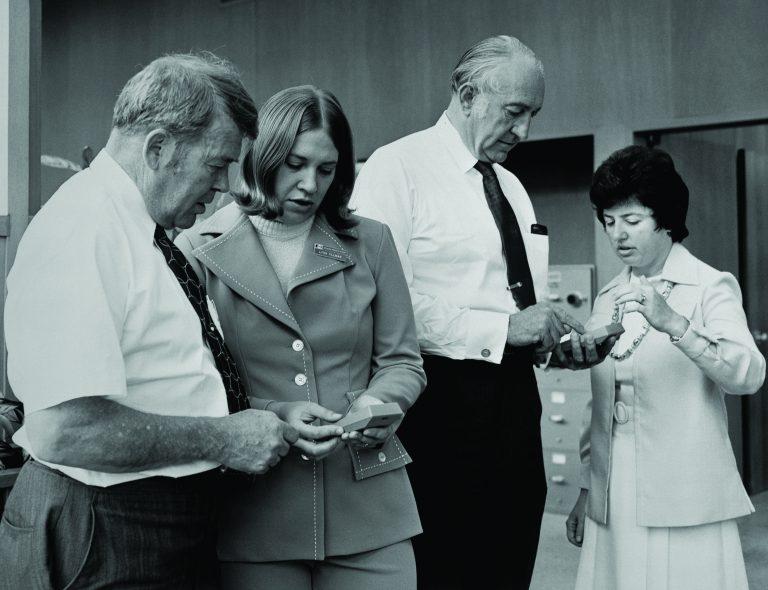 Lynn Tillman and Janet Loustanou giving Bill Hewlett and Dave Packard a tutorial on the HP 70 financial calculator.