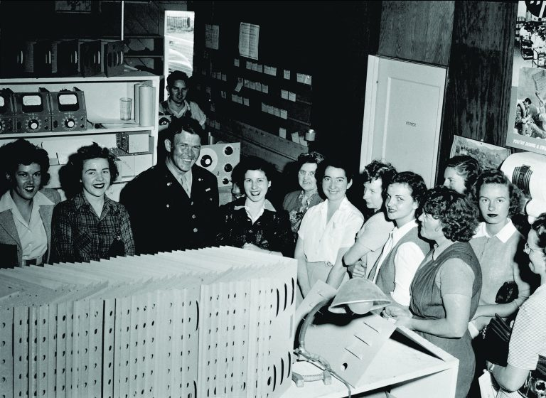 Bill Hewlett with a number of female employees during a visit to HP in 1944 when he was a major in the Army.