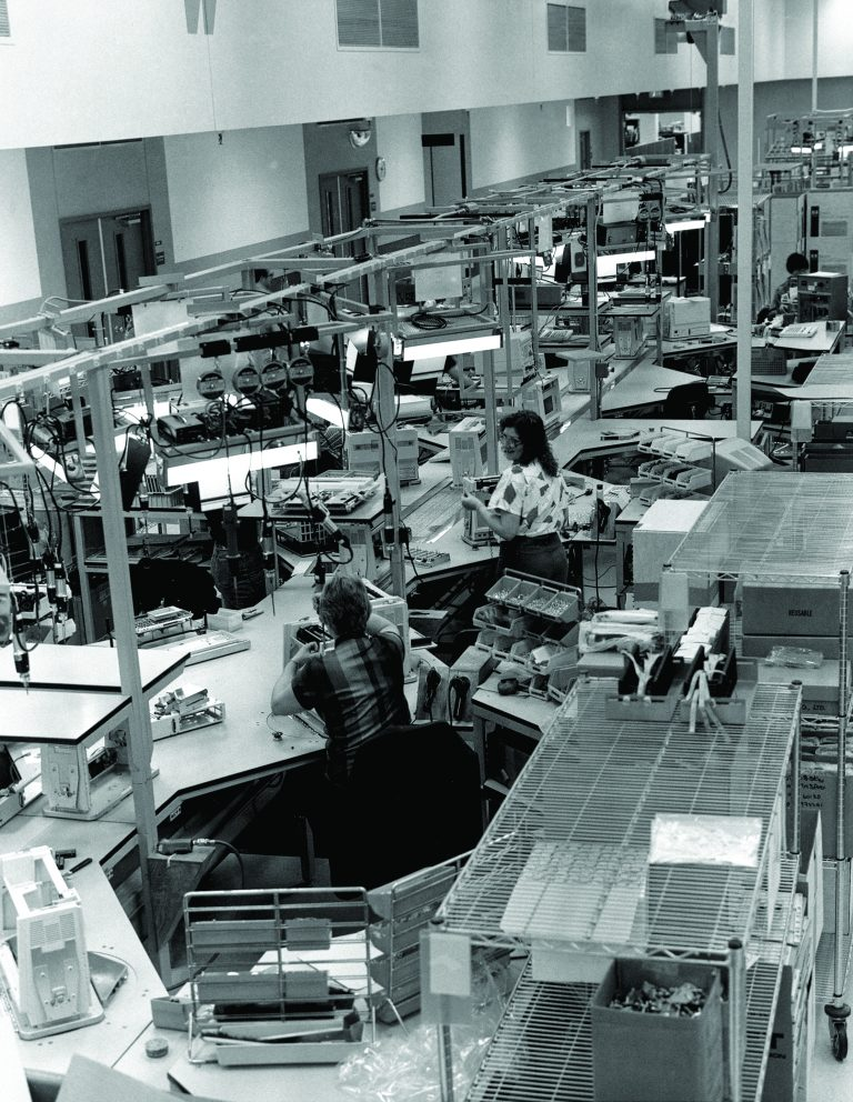 Two women working on the production line assembling Hewlett-Packard Integral luggable PCs in 1985.