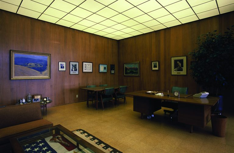 A photo of Dave Packard's preserved office at 1501 Page Mill Road with wood panel walls and original furniture and décor.