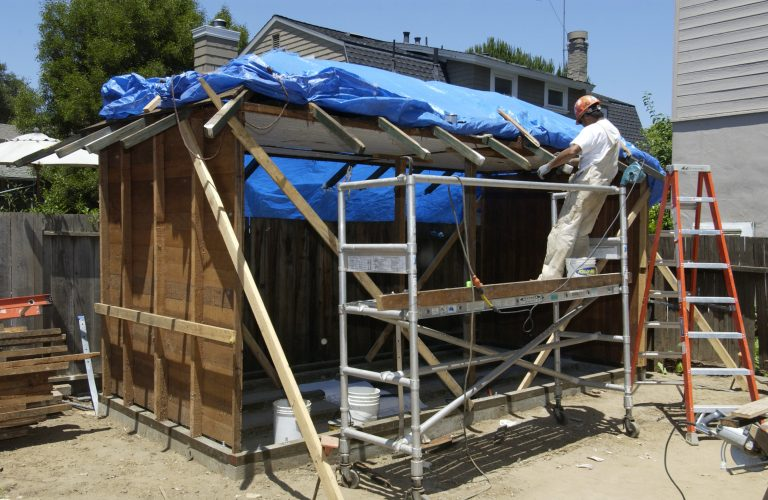 A worker working on the roof of Bill Hewlett's shed on Addison Avenue.
