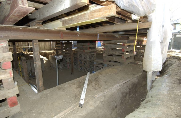 A view of the supports added while repairs were completed on the foundation of the main house on Addison Avenue.