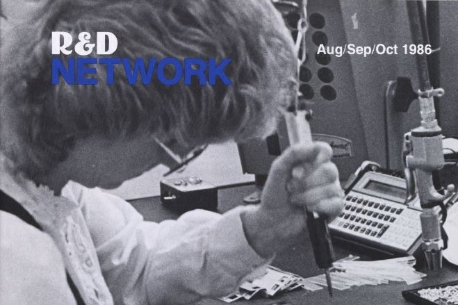 Cover of R&D Network from the fall of 1986 featuring Collen Kimble working on the final assembly of a series 10C calculator.