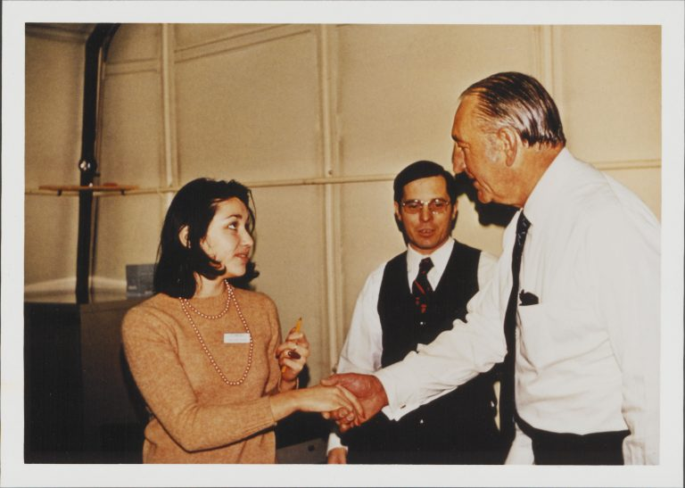 Dave Packard speaking with a female employee in the 1960s.