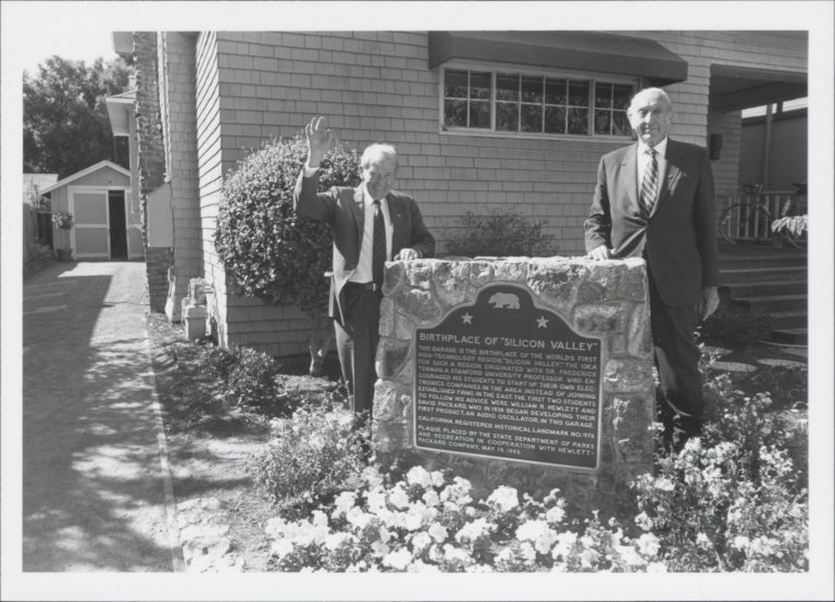 Bill Hewlett and Dave Packard standing beside the historic marker in front of 367 Addison Avenue.