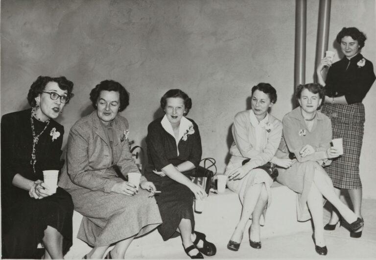 A group of six women celebrating Hewlett-Packard's 15th anniversary.